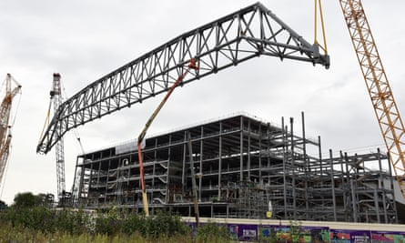 Shares in Carillion, which worked on the expansion of Liverpool FC's main stand, above, fell after it revealed a slowdown in orders.