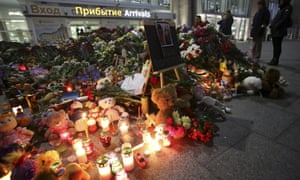 People mourn at a makeshift memorial for victims of Russian airliner