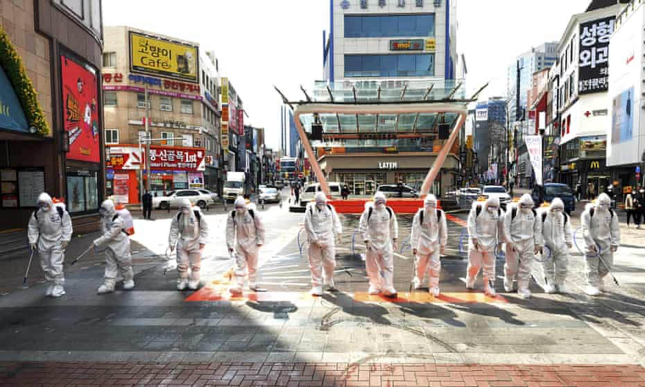 South Korean soldiers spray disinfectant to prevent the spread of Covid-19 in Daegu, South Korea