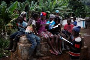 Children gather to read school books