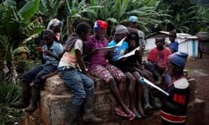 Children gather and read school books in Boucan Ferdinand, Haiti
