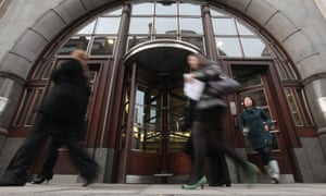 Female employees leave the Goldman Sachs building in central London