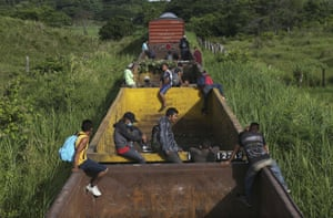 Salto del Agua, MexicoHonduran migrants ride a freight train on their way north. The group's next stop will be Coatzacoalcos, Veracruz state.