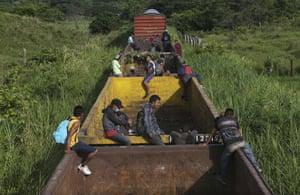 Honduran migrants ride a freight train in Salto del Agua on their way north.