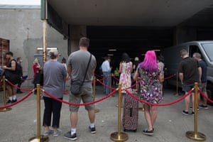 People waiting in queue at the Opera Australia warehouse.
