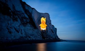 A satirical image of the US president as a baby is projected on to the white cliffs of Dover, during his visit to the UK last week.