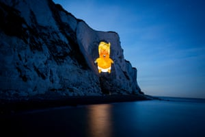 A projection of the Trump baby blimp lights up the white cliffs of Dover, UK