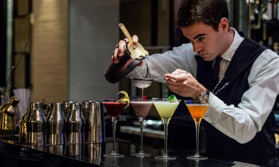 A barman pours cocktails