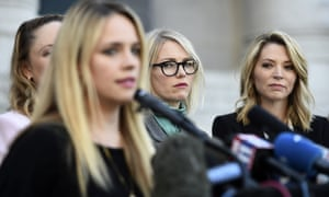 Actors Melissa Sagemiller Nesic, centre, and Katherine Kendall, right, listen to Jessica Barth speak at a news conference by the Silence Breakers in LA last week