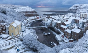 Snow covers the coast in Staithes, North Yorkshire