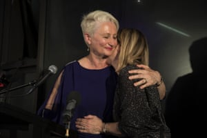 Independent candidate for Wentworth Kerryn Phelps (left) is embraced by her wife Jackie Stricker-Phelps during her victory speech.