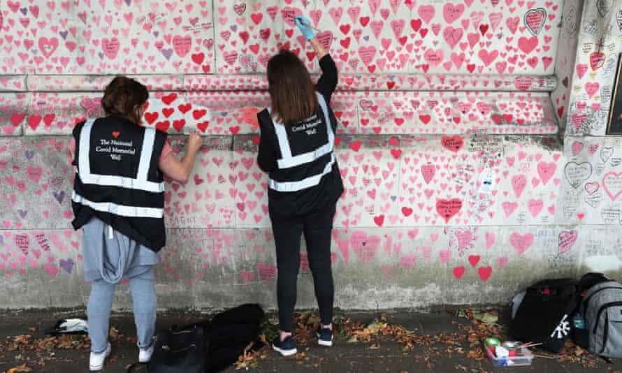 Volunteers working on the wall.