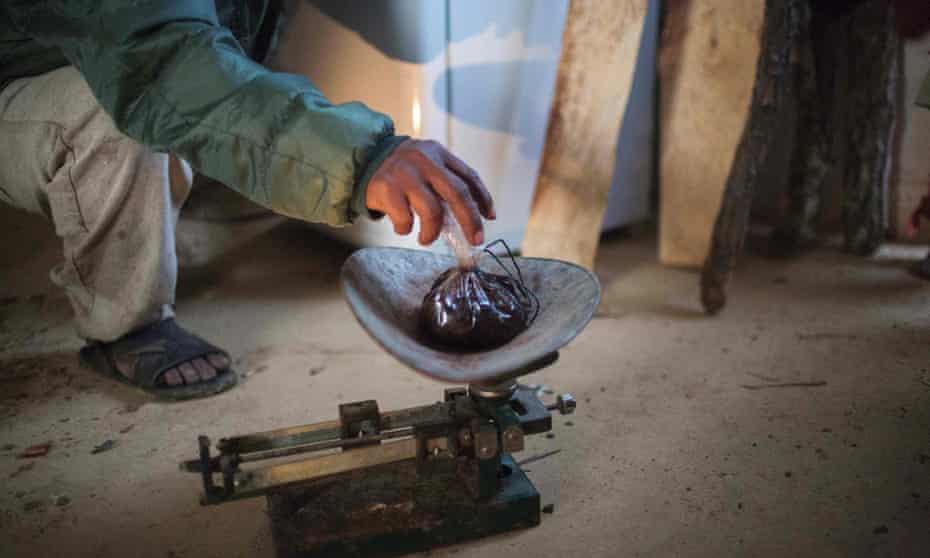 Man weighing opium