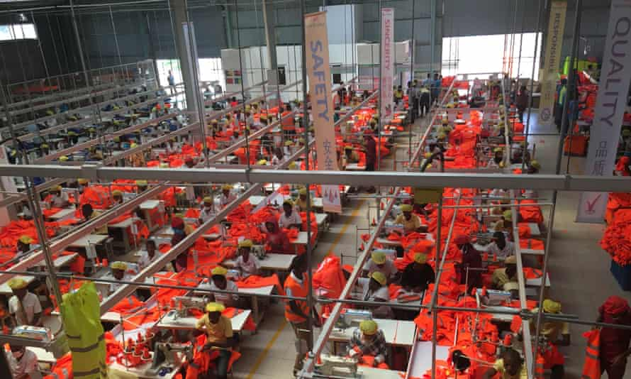 Rwandan workers make safety uniforms at C&H Garments, a Chinese factory with operations in Kigali.