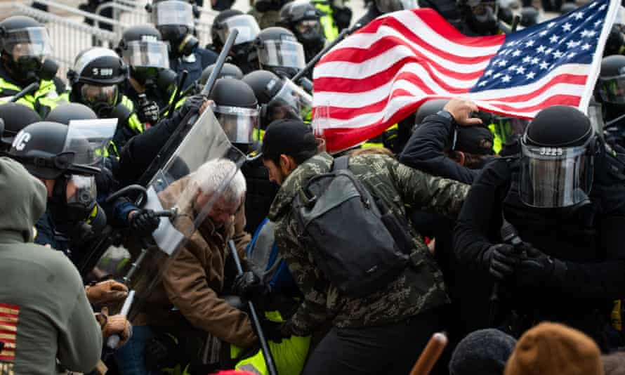 Supporters of US President Donald Trump fight with riot police outside the Capitol building on January 6, 2021