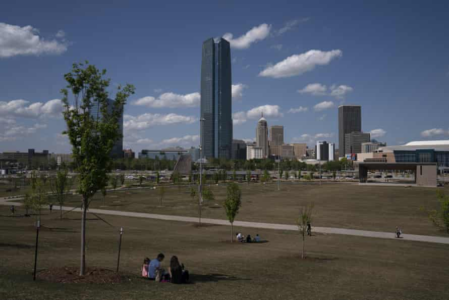 People sit at a distance in downtown Oklahoma City in late April.