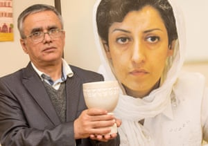 Taghi Rahmani holds the Weimar Human Rights Award in place of his wife Narges Mohammadi from Iran, in Germany, 10 December 2016.