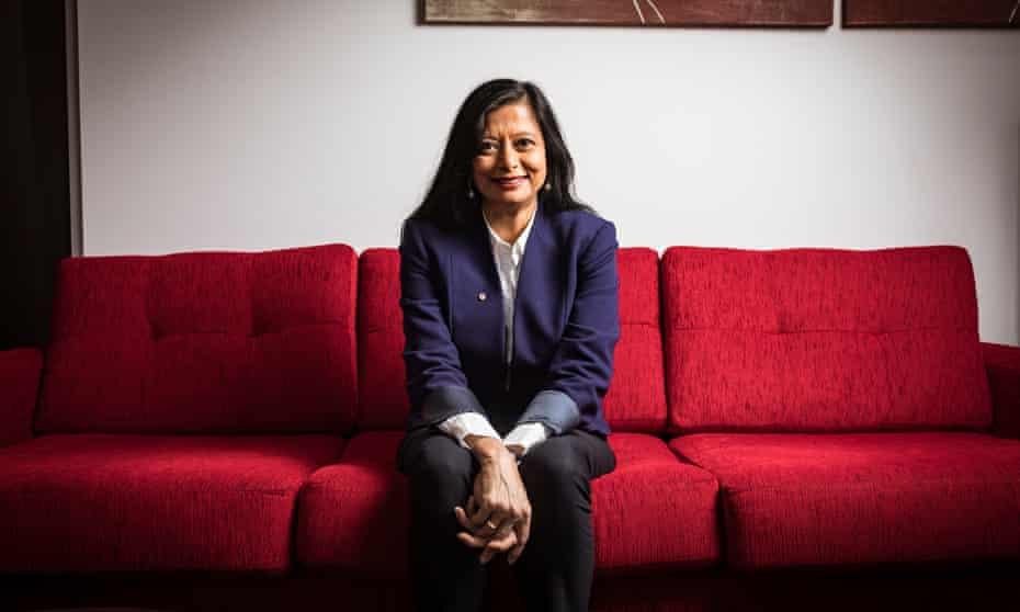 Psychiatry professor Jayashri Kulkarni on a red couch
