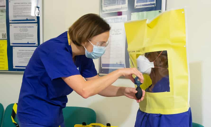 A member of intensive care staff, is 'fit-tested' for an FFP3 mask. There are now demands for anyone caring for a Covid-19 patient to have one.