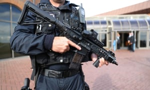 An armed police officer on patrol.