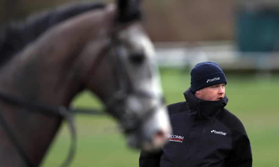 Gordon Elliott said a photograph showing him sitting on a dead horse was 'a moment of madness'.