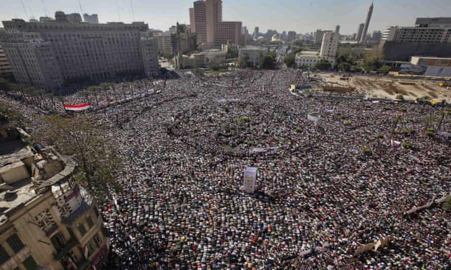 Egyptians in Tahrir Square, Cairo, pray and celebrate the fall of former President Hosni Mubarak's regime in February 2011.