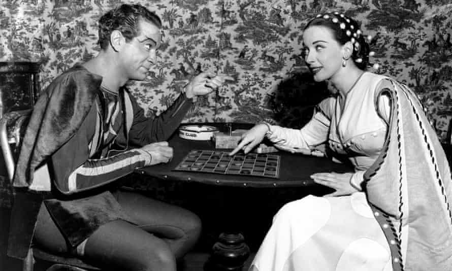 Alfred Drake, left, and Patricia Morison, backstage at the New Century theatre, in New York, during a performance of Kiss Me, Kate in 1949.
