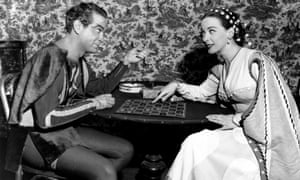Alfred Drake and Morison play checkers backstage at the New Century Theatre in New York, while starring in Kiss Me, Kate.