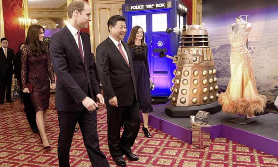 Prince William and Xi Jinping walk past a Doctor Who display at Lancaster House in London.