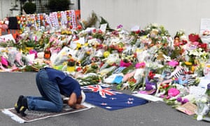 A man prays at a makeshift memorial at Al Noor Mosque in Christchurch.