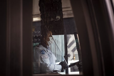 A driver wearing a protective mask operates a Chicago Transit Authority bus in Chicago, Illinois, in April.