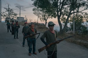 Children during a community police force gun training session in Ayahualtempa, in Guerrero state, Mexico