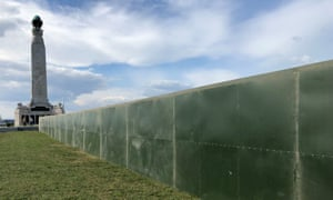 Dividing wall: a military-style metal fence has been put up in Portsmouth to protect Donald Trump.