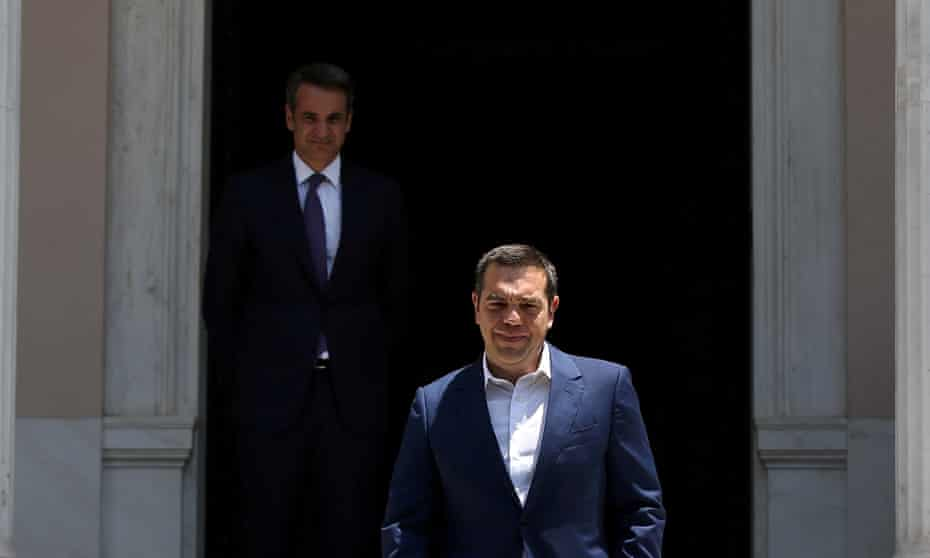 Alexis Tsipras, right, walks away from his successor, Kyriakos Mitsotakis