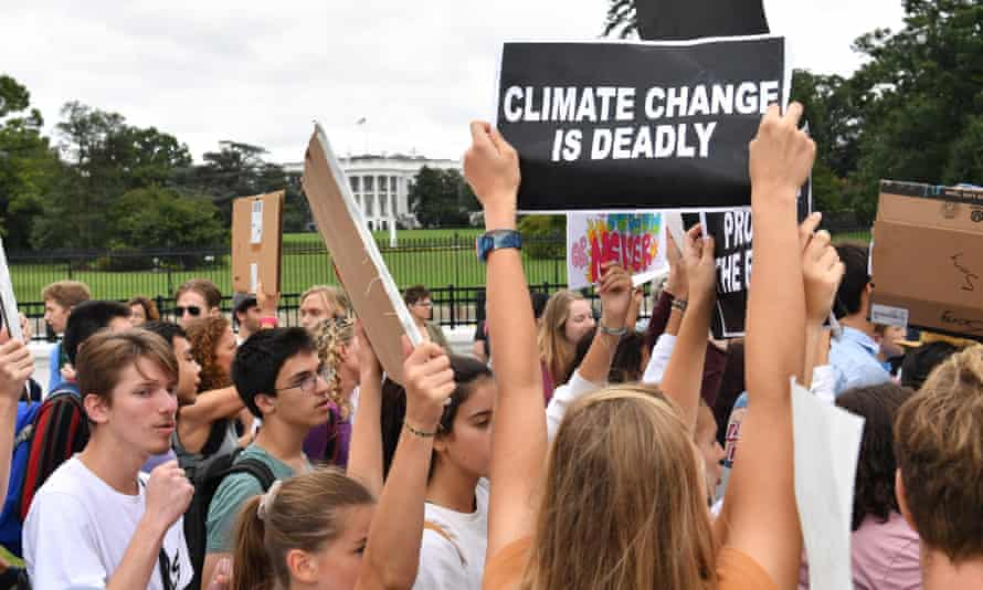 Youth activists take art in a climate protest outside the White House in Washington DC, on 13 September.