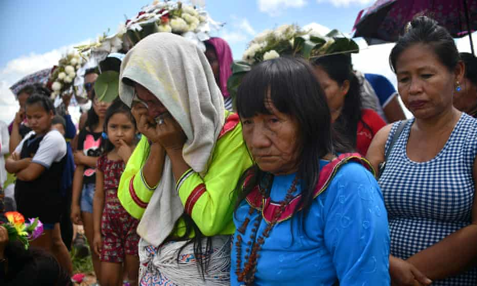 People attend the burial of Olivia Arevalo, who was shot dead near her home. Ayahuasca has been used successfully to treat PTSD and drug addictions, but there is a darker side.