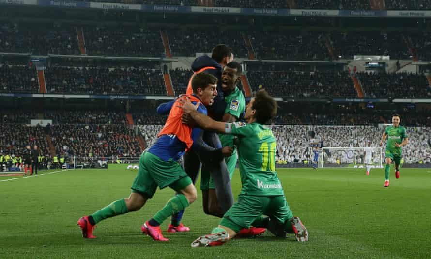 Alexander Isak celebrates with teammates after his acrobatic finish put Real Sociedad 2-0 up.