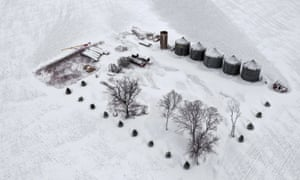 An aerial view of snow blanketing a farm in Rudd, Iowa, on 27 November.