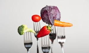 Forks holding fruit and vegetables