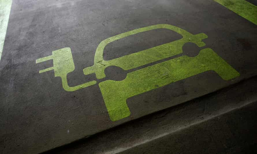 A sign is painted on a parking space for electric cars inside a car park in Hong Kong