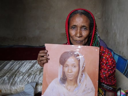 Khadidja Zidane holds a picture of her as a young woman, newly married, before she was arrested and raped by Habré.