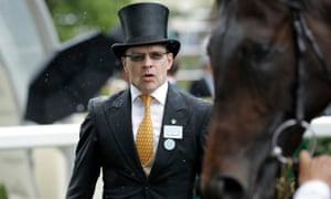 Trainer Aidan O'Brien looks at his Coventry Stakes winner Arizona.