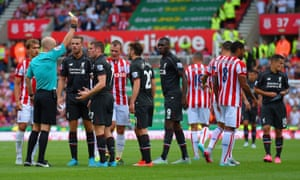 James Milner is shown a yellow card at the Britannia Stadium