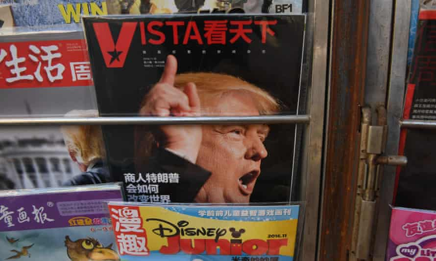 A magazine features a cover story about Donald Trump on a news stand in China
