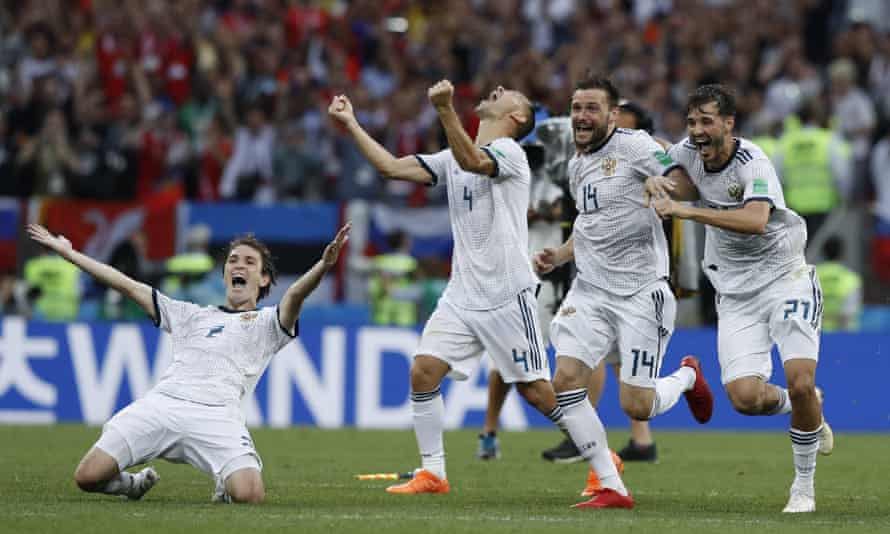 Mário Fernandes leads the celebrations as Russia beat Spain on penalties in the last 16.