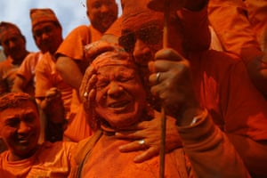 Joyous celebration as devotees cover themselves in powder