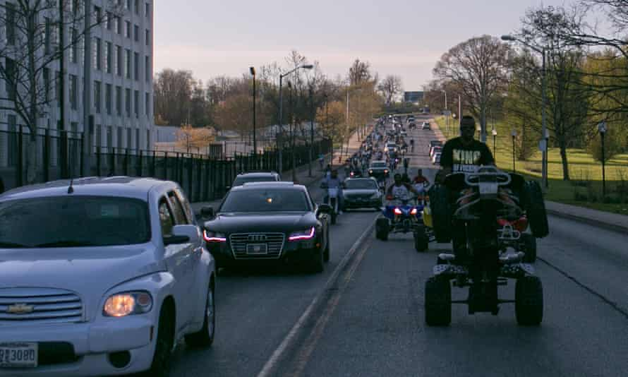 Loud, fast and unpredictable, the pack swarms through traffic on a Sunday ride out in Baltimore