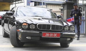 The car used by the North Korean ambassador to Malaysia leaves the forensic department of a Kuala Lumpur hospital on Wednesday