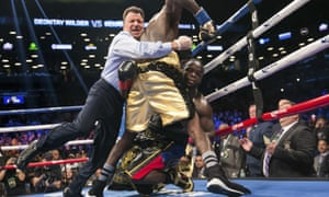 The referee pulls Deontay Wilder away from Bermane Stiverne after the American knocked out the Haitian-Canadian.