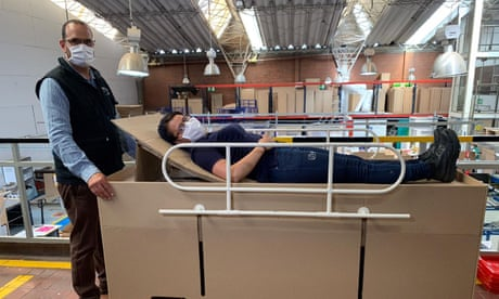 Colombian designers prepare cardboard hospital beds that double as coffins